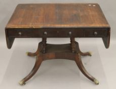 A 19th century rosewood sofa table.