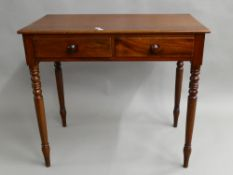 A Victorian mahogany two drawer side table. 86 cm wide, 47.5 cm deep, 76.5 cm high.
