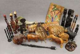 A collection of ethnographic items, including wood carvings, a shell covered board, etc.