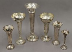 Six silver trumpet vases. The largest 28 cm high. 37.2 troy ounces weighted.