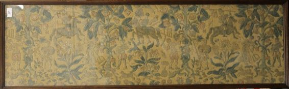 An embroidered woolwork depicting Horsemen, Fruit Trees, etc., framed and glazed.