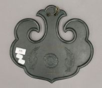 A Japanese patinated bronze plaque with presentation inscription. 32 cm wide.