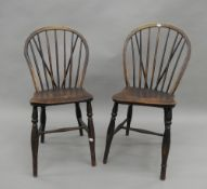 A pair of 19th century elm seated stickback chairs.