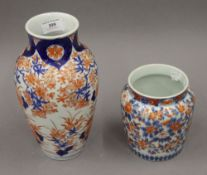 Two Japanese Imari vases. The largest 25 cm high.