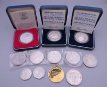 A gold plated silver medallion, a silver proof coin and a small quantity of other coins.
