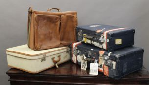 A leather travelling bag and two vintage suitcases