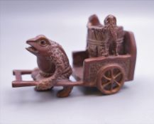 A Japanese model of a toad pulling a cart. 8 cm long.