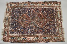 A small red ground rug. 150 x 111 cm.