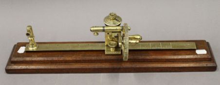 A 19th century Goodbrand and Co of Manchester brass tensile thread tester gauge. 51.5 cm long.