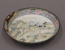 A 19th century Chinese enamel dish. 20.5 cm diameter.