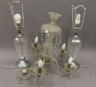A cut glass chandelier and a pair of table lamps. The former 53 cm high.