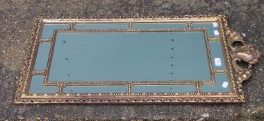 A 20th century gilt framed wall glass/mirror. 52.5 x 94 cm.