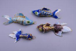 Four enamel decorated fish. The largest 8 cm long.