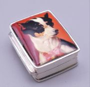 A silver pill box decorated with a chihuahua. 3.25 cm high.