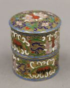 A Chinese enamel decorated two section lidded box. 7 cm high.