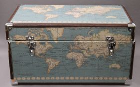 A set of three trunks depicting maps. The largest 67 cm wide.