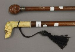 Two walking sticks, one with celluloid dog's head handle,