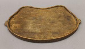 A Robert 'Mouseman' Thompson oak kidney shaped tray. 47 cm wide.