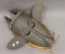 An African wooden mask. 60 cm high.