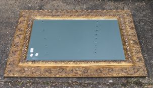 A modern decorative gilt framed mirror and another. The former 77 x 103 cm.