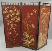 A Victorian rosewood three-fold screen with embroidered panels. 173 cm high.