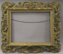 A Venetian carved wooden frame. external size 68.5 x 58.5 cm ,inner size 46 x 36 cm.