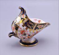 A Royal Crown Derby miniature porcelain coal scuttle. 6.5 cm high.
