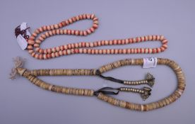 Two Tibetan bead necklaces. The largest approximately 70 cm long.