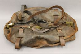 A large Victorian leather Gladstone bag. Approximately 66 cm long.