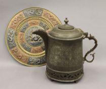 A large Tibetan brass teapot and an Indian brass charger. The former 31 cm high.