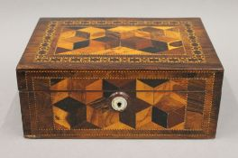 A Victorian Tunbridgeware box inlaid with various exotic woods to give a tumbling box effect.