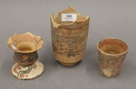 Three antiquity vessels. The largest 13 cm high.