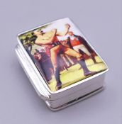 A silver pill box decorated with a boxer. 3.25 cm high.