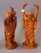 A pair of Chinese carved wooden figures. The largest 36 cm high.