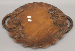 An Eastern carved wooden tray with floral decoration. 46.5 cm wide.