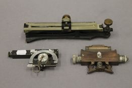 Three inclinometers. The largest 23 cm long.