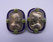 A pair of enamel decorated silver cufflinks, bearing Russian marks. 2.25 cm high.