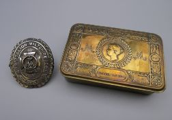 A WWI Christmas 1914 brass tin given to the troops by Princess Mary and a pouch badge '4th Battn,