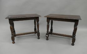 A pair of early 20th century carved oak stools. 58.5 cm wide.