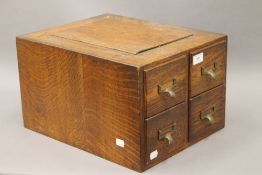 An early 20th century oak bank of four filing drawers. 33 cm wide.