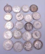 Twenty silver 6pence coins,