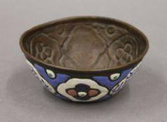 An antique Persian enamel decorated copper bowl. 12 cm diameter.