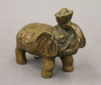 A Chinese bronze model of an elephant. 15.5 cm long.