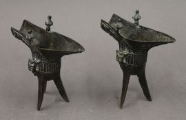 A pair of Chinese bronze jues. 14 cm high.