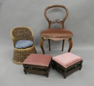 Two Victorian foot stools, a walnut balloon back chair and a cane child's chair.