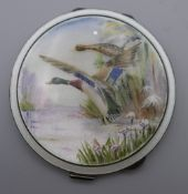 A silver and enamel 1957 Garrard's of London compact. 7.5 cm diameter.