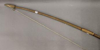 A vintage archery bow. 158 cm long.