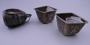Three Chinese silver salts. The largest 6.5 cm high.