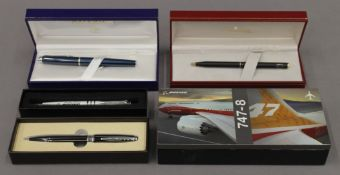 A selection of cased pens,