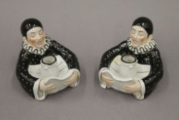 A pair of porcelain candlesticks in the form of Pierrot. Each 10.5 cm high.